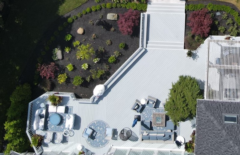 Sky View of a Patio with Seating and Surrounding Landscape