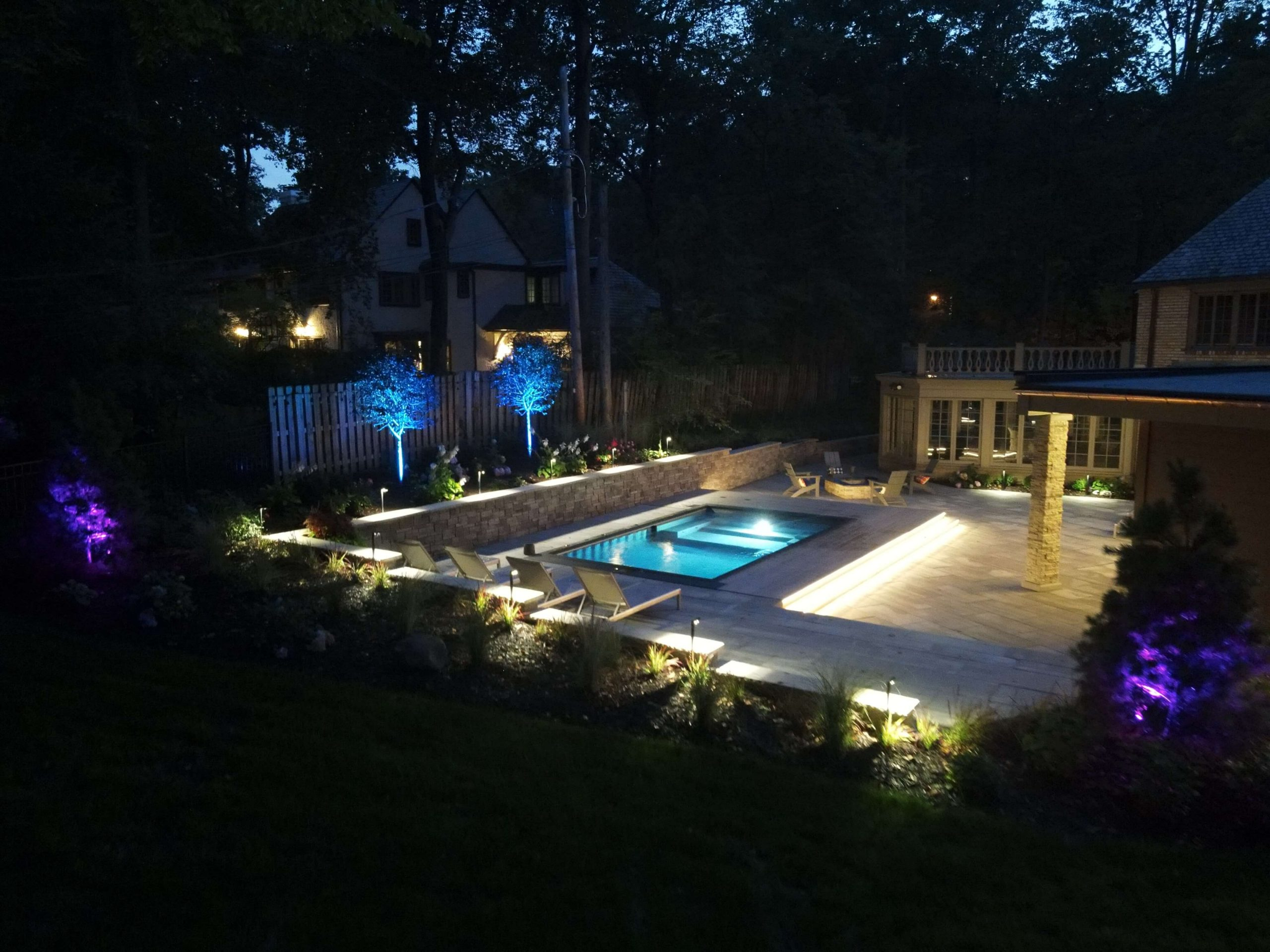 Lit Up Pool Area In Evening
